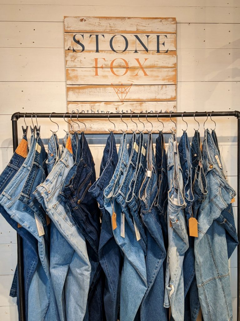 Stone fox consignment jeans vintage clothing rack